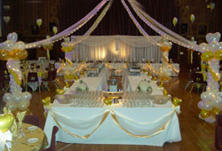 Balloon columns and canopy over buffet tables