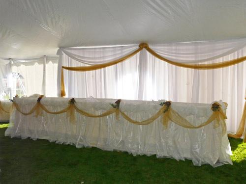 Organza clouds on head table in tent